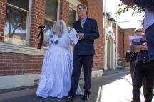 The bride (Bridget Doyle) arrives