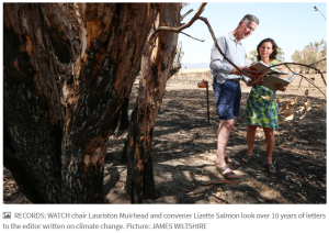 Photo of Lauriston Muirhead and Lizette Salmon looking over ten years of letters to the editor on climate change.